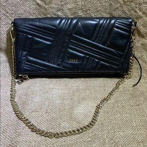 Brand new DKNY black fold over crossbody bag